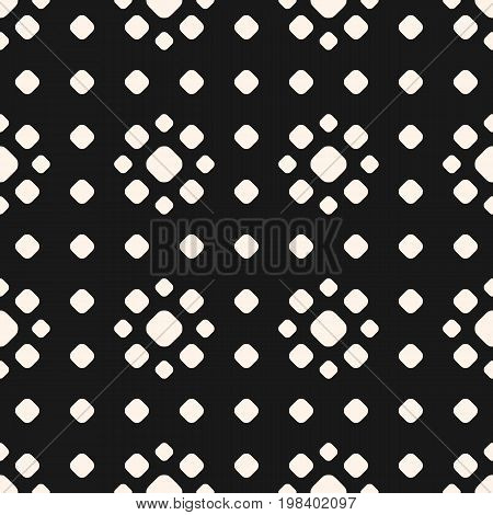Dotted seamless pattern, vector monochrome polka dot texture with different sized circles, stippling floral shapes. Abstract black geometric background, repeat tiles. Design for prints, decor, covers.