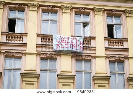 Protest Slogan On Building Facadein Berlin Saying