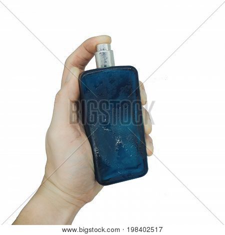 the isolated bottle fragrant perfumes in the hands on white background