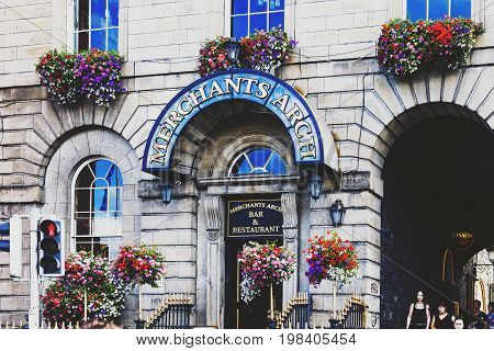 DUBLIN IRELAND - July 15th 2017: detail of the historical Merchants Arch in the Temple Bar district in Dublin Ireland right in front of the Ha'Penny bridge (with unidentified people)