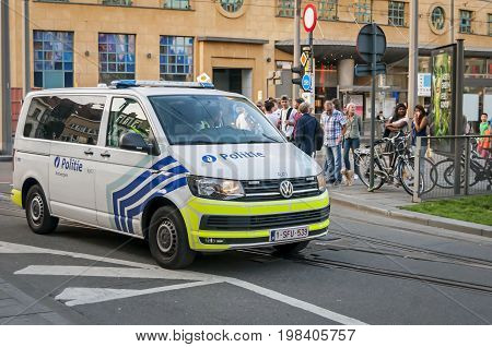ANTWERP, BELGIUM. July 19, 2017. Belgium Volkswagen police minibus car on a square in front of the Antwerp central station.