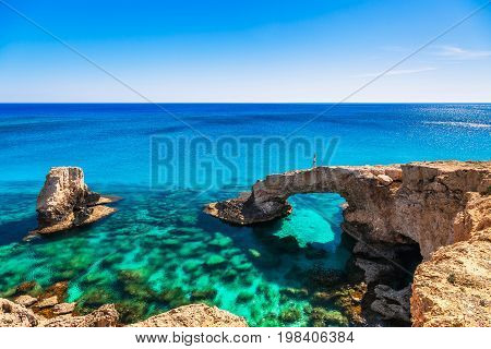 Woman On The Beautiful Natural Rock Arch Near Of Ayia Napa, Cavo Greco And Protaras On Cyprus Island