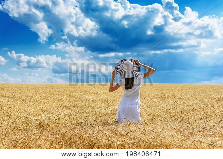Beautiful Young Woman With Brown Hear With Raised Arms Enjoying Outdoors Looking To The Sun On Perfe
