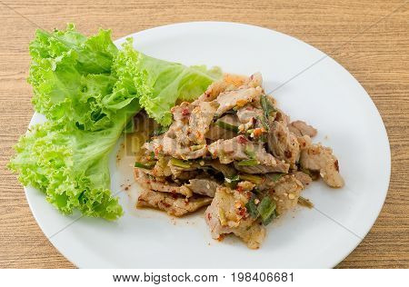 Thai Cuisine and Food Thai Traditional Nam Tok or Spicy Beef Salad Served with Lettuce Leaves.