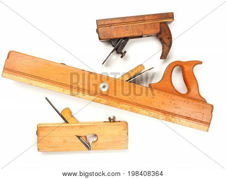Three old used wood plane on a white background traditional wood working tools