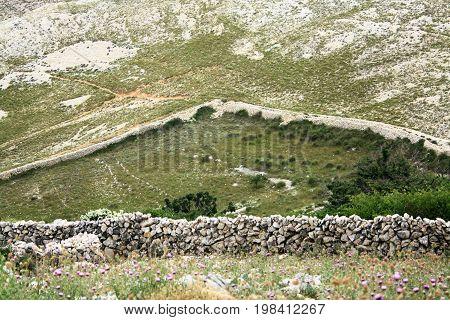 sheepwall on the hiking trail to lighthouse, Baska, island Krk, Croatia
