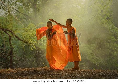 Buddhism two novice monk is wearing yellow cloth together