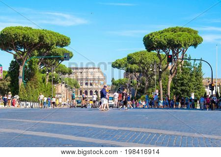 Roma, Italy - July, 2, 2017: group of tourists on segways stand in front of Colosseum, ancient Roman amphitheater, one of the main sights of Rome