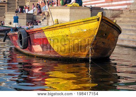 Colorful boats at Ganges river Varanasi, India.