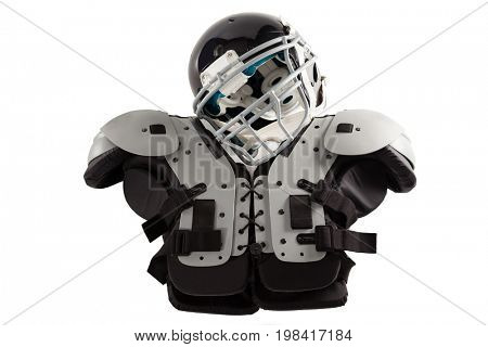 Close up of sports helmet on chest protector against white background