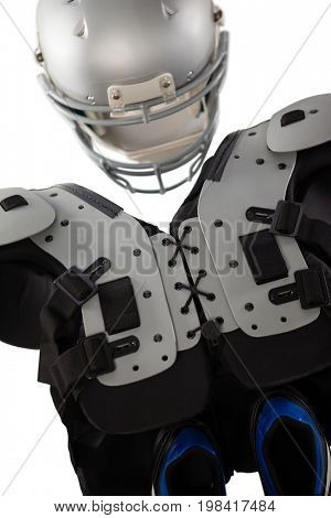 Chest protector with sports helmet and shoes on white background