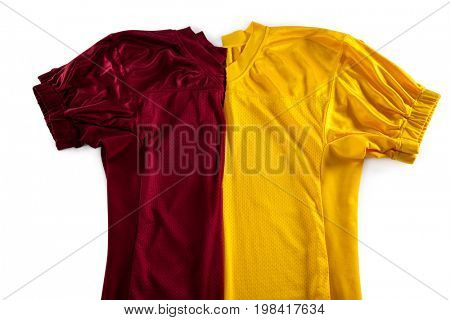 High angle view of red and yellow jersey on white background