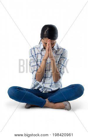 Beautiful woman praying against white background