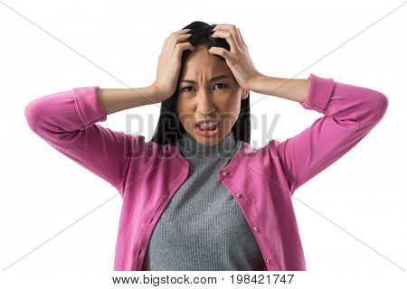 Portrait of depressed woman standing against white background