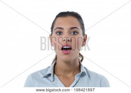 Portrait of surprised female executive standing against white background