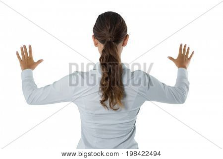 Rear view of female executive gesturing against white background