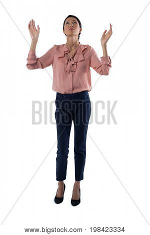 Worried Female executive praying against white background