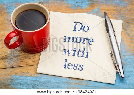 Do more with less advice or reminder - handwriting on a napkin with a cup of coffee