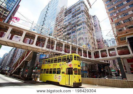 HONG KONG – JULY 15, 2017: Electric trolleys and motor vehicles on street in Hong Kong, China