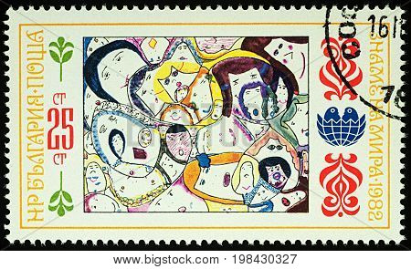 Moscow Russia - August 03 2017: A stamp printed in Bulgaria shows children's drawing of people's faces series