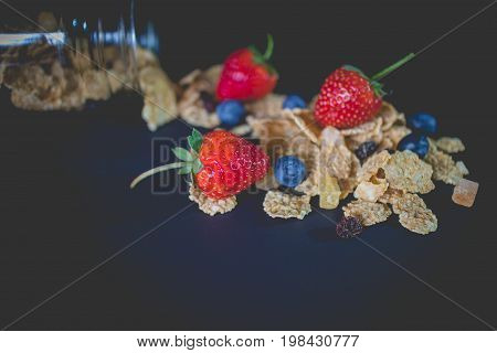 whole grain cereal flakes which mixed berry fruit and raisins. Cereal breakfast with strawberry. cereal cornflakes with blueberry