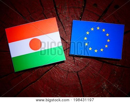 Niger Flag With Eu Flag On A Tree Stump Isolated