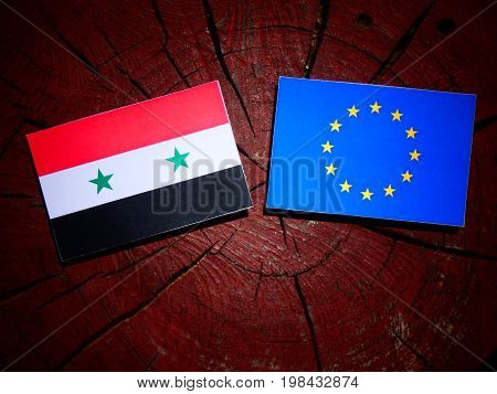 Syrian Flag With Eu Flag On A Tree Stump Isolated