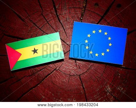 Sao Tome And Principe Flag With Eu Flag On A Tree Stump Isolated