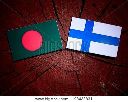 Bangladesh Flag With Finnish Flag On A Tree Stump Isolated