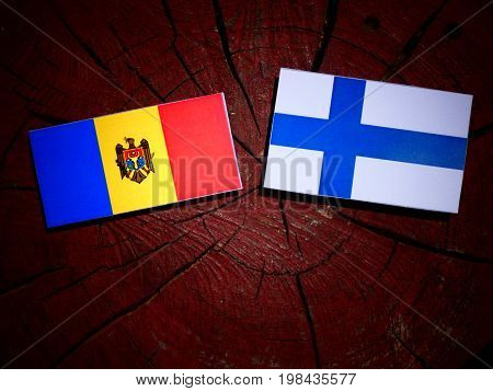 Moldovan flag with Finnish flag on a tree stump isolated poster