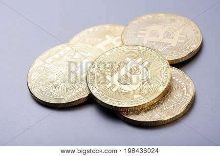Gold bit coins on the background to illustrate block chain cyber currency and electronic payments