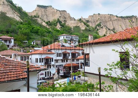 Melnik, Bulgaria - May 11, 2017: Aerial view with traditional bulgarian houses of Revival period and pyramid mountain rocks in Melnik, Bulgaria