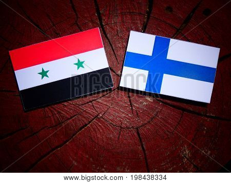 Syrian Flag With Finnish Flag On A Tree Stump Isolated