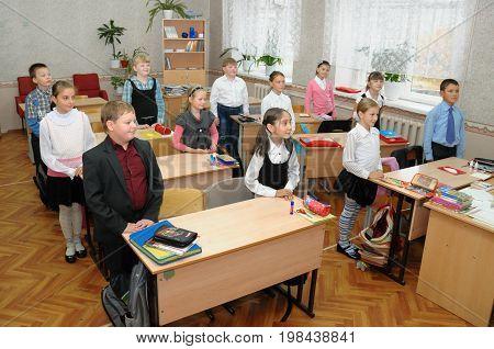 Gajievo, Russia - September 09, 2010: Children greet the teacher before the lesson begins