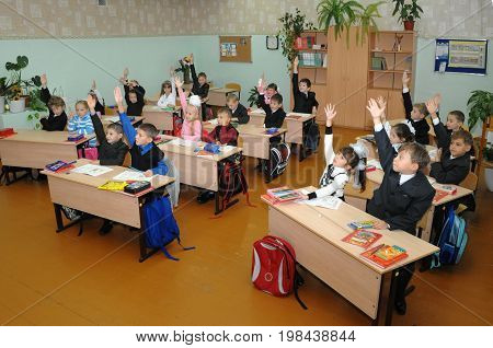 Gajievo, Russia - September 09, 2010: First graders are ready to answer the teacher's question