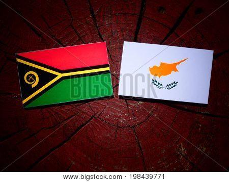 Vanuatu Flag With Cypriot Flag On A Tree Stump Isolated