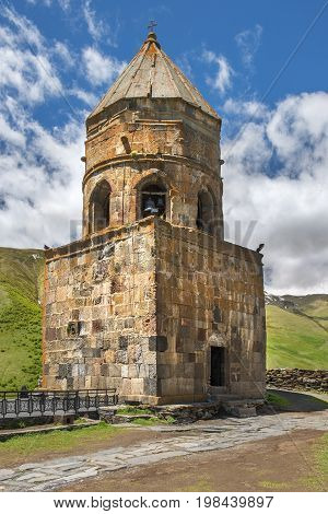 old bell tower, Gergeti Trinity Church (Tsminda Sameba), Holy Trinity Church near the village of Gergeti in Georgia, under Mount Kazbegi