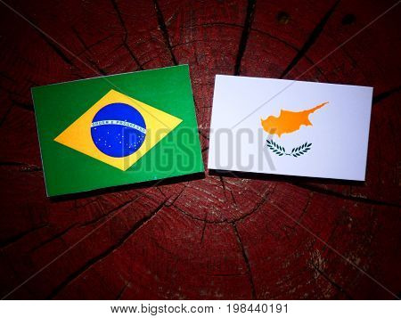 Brazilian Flag With Cypriot Flag On A Tree Stump Isolated