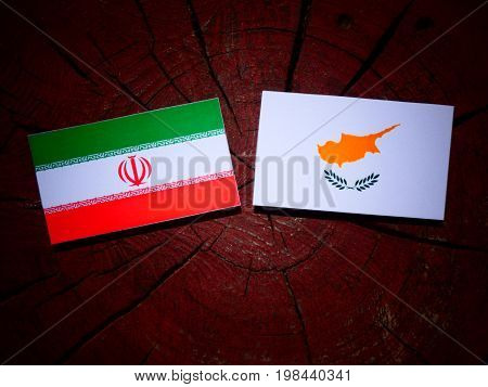 Iranian Flag With Cypriot Flag On A Tree Stump Isolated
