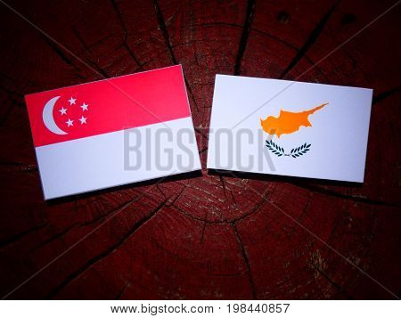 Singaporean Flag With Cypriot Flag On A Tree Stump Isolated
