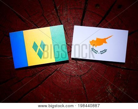 Saint Vincent And The Grenadines Flag With Cypriot Flag On A Tree Stump Isolated