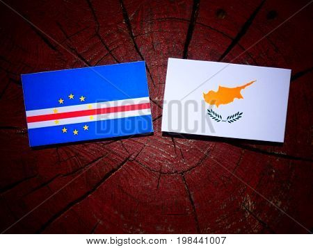 Cape Verde Flag With Cypriot Flag On A Tree Stump Isolated