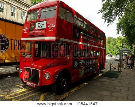 Red bus in Edinburgh. Edinburgh, Scotland - July 27, 2017 Double deck tour bus on a street in Edinburgh.