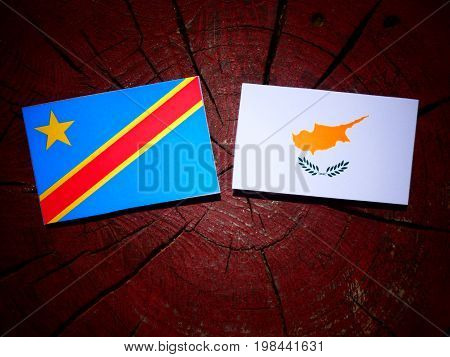 Democratic Republic Of The Congo Flag With Cypriot Flag On A Tree Stump Isolated
