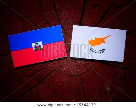 Haitian Flag With Cypriot Flag On A Tree Stump Isolated