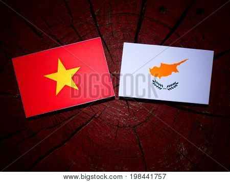 Vietnamese Flag With Cypriot Flag On A Tree Stump Isolated