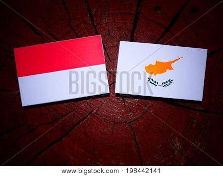 Indonesian Flag With Cypriot Flag On A Tree Stump Isolated