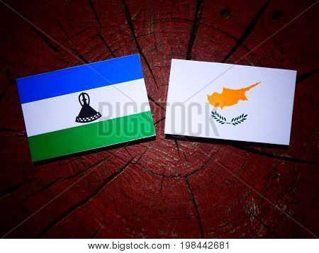 Lesotho Flag With Cypriot Flag On A Tree Stump Isolated