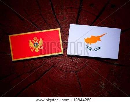 Montenegrin Flag With Cypriot Flag On A Tree Stump Isolated