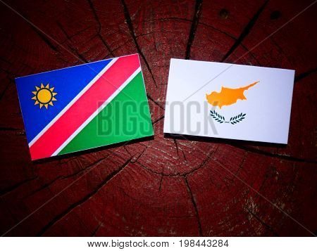 Namibian Flag With Cypriot Flag On A Tree Stump Isolated
